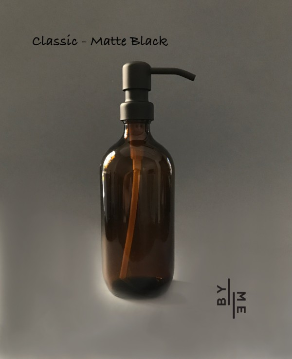 amber glass bottle with matte black metal pump