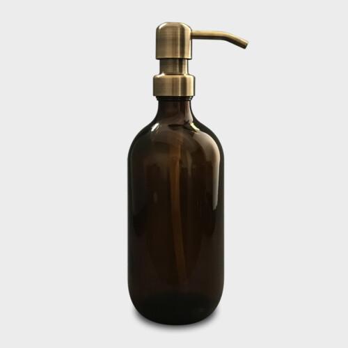 Amber glass bottle with brass soap dispenser
